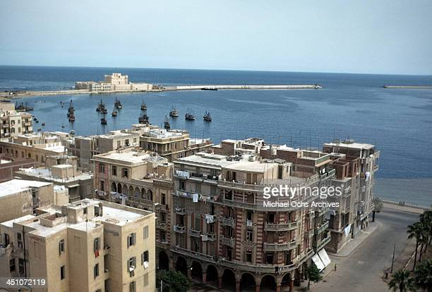An aerial view of buildings and a harbor in Alexandria Egypt