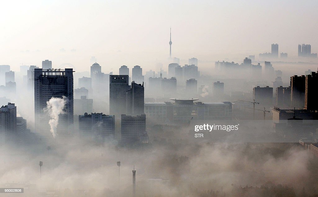 An aerial view of buildings standing out amid haze engulfing Wuhan central China's Hubei province on December 3 2009 China will need to invest up to...
