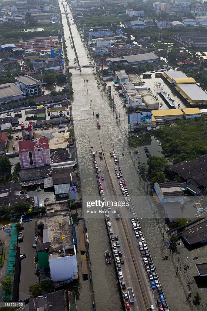An aerial view of cars parked on a highway in flooded district just outside the capitol city November 7, 2011 in Bangkok, Thailand. Over seven major industrial parks in Bangkok and thousands of factories have been closed in the central Thai province of Ayutthaya and Nonthaburi with millions of tons of rice damaged. Thailand is experiencing the worst flooding in over 50 years which has affected more than nine million people.