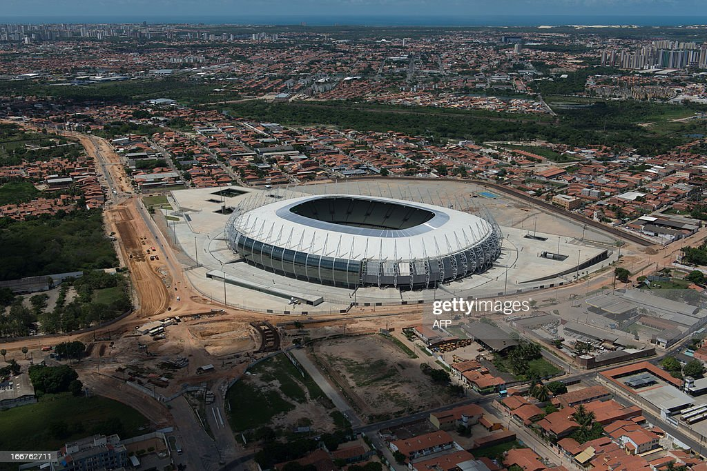 An aerial view of Castelao Arena, in Fortaleza, state of Ceara, in northeastern Brazil, on April 16, 2013. Fortaleza will host the upcoming FIFA Confederations Cup matches Brazil vs Mexico, Spain vs Nigeria and the semi-final. AFP PHOTO/Yasuyoshi CHIBA