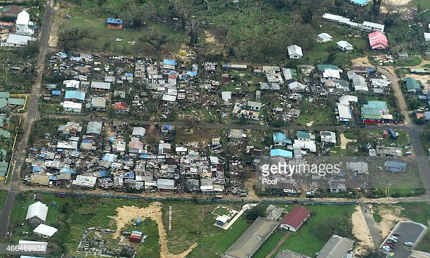 An aerial view of damaged houses in seen on March 16 2015 in Port Vila Vanuatu Cyclone Pam has hit South Pacific islands on Saturday with hurricane...