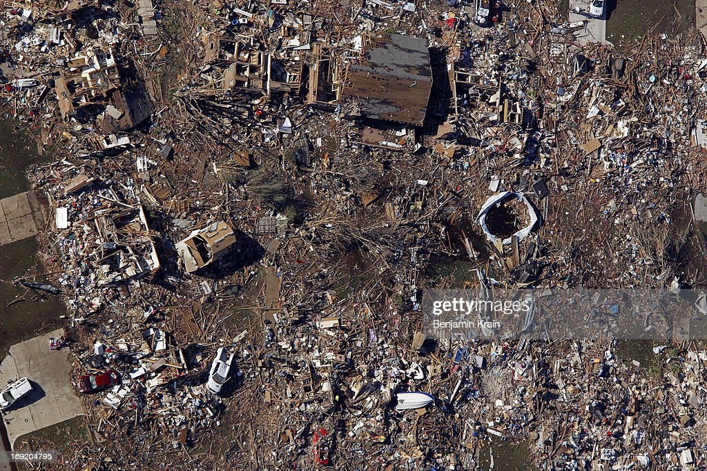An aerial view of destroyed houses after a powerful tornado ripped through the area on May 21, 2013 in Moore, Oklahoma. The town reported a tornado of at least EF4 strength and two miles wide that touched down yesterday killing at least 24 people and leveling everything in its path. U.S. President Barack Obama promised federal aid to supplement state and local recovery efforts.