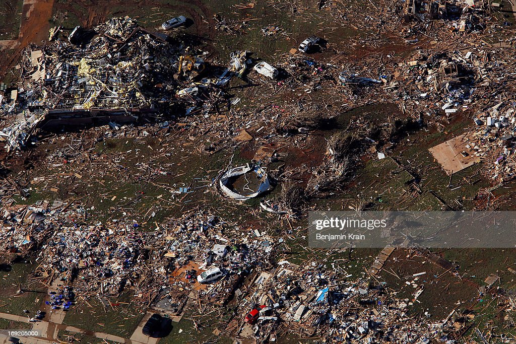 An aerial view of destroyed houses and buildings after a powerful tornado ripped through the area on May 21, 2013 in Moore, Oklahoma. The town reported a tornado of at least EF4 strength and two miles wide that touched down yesterday killing at least 24 people and leveling everything in its path. U.S. President Barack Obama promised federal aid to supplement state and local recovery efforts.