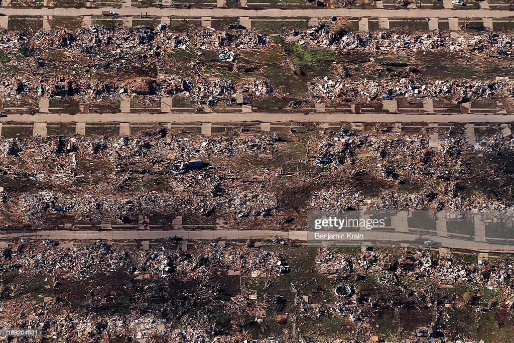 An aerial view of destroyed houses and buildings on May 21, 2013 in Moore, Oklahoma. The town reported a tornado of at least EF4 strength and two miles wide that touched down yesterday killing at least 24 people and leveling everything in its path. U.S. President Barack Obama promised federal aid to supplement state and local recovery efforts.