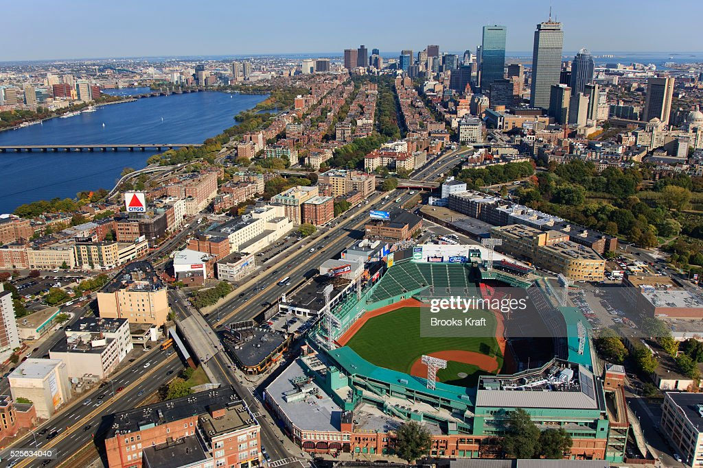 An aerial view of Fenway Park home of the Boston Red Sox Major League Baseball team In the background is the Charles River and the skyline of Boston