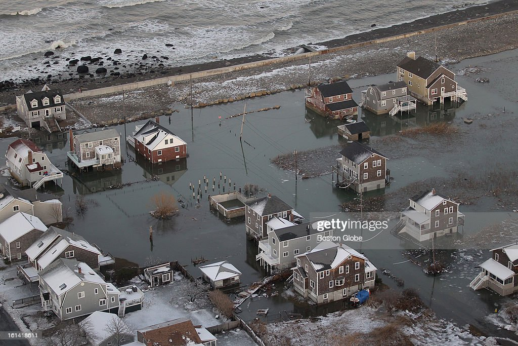 An aerial view of flooded homes without power in Scituate, Mass. on Sunday, Feb. 10, 2013, after a blizzard hit New England.