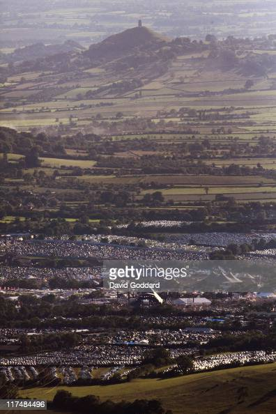 An aerial view of Glastonbury Tor rising behind the Glastonbury Festival site at Worthy Farm in Pilton on June 26 2011 in Glastonbury England The...