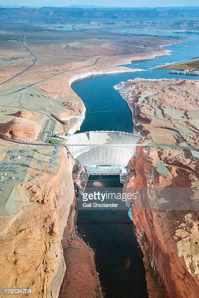 CONTENT] An aerial view of Glen Canyon Dam Page Arizona USA The bright blue objects at the bottom of the dam to the right are the rafts which take...