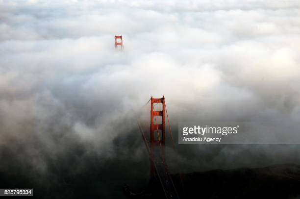 An aerial view of Golden Gate Bridge during the foggy weather in San Francisco CA United States on August 03 2017