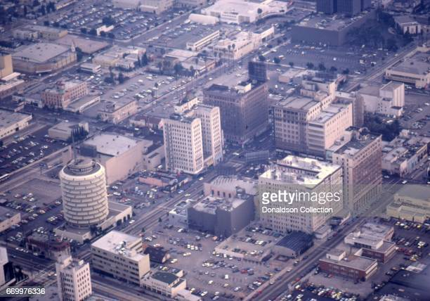 An aerial view of Hollywood including the Capitol Records building the Hotel Knickerbocker and the corner of Hollywood and Vine in October 1977 in...