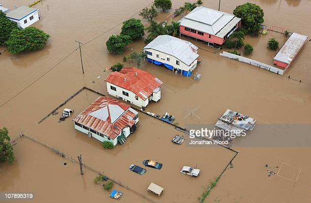 An aerial view of homes surrounded by flood waters on January 6 2011 in Rockhampton Australia Floodwaters peaked at 92 metres yesterday in the...