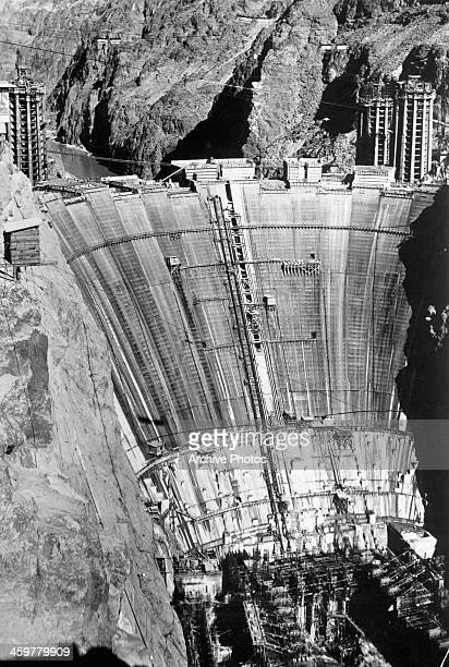 An aerial view of Hoover Dam during the construction at the Nevada Arizona border Circa 1935