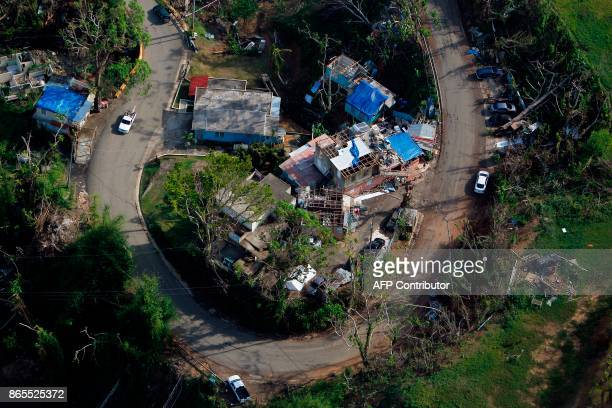 TOPSHOT An aerial view of houses affected by the passing of Hurricane Maria in Naranjito Puerto Rico October 23 2017 / AFP PHOTO / Ricardo ARDUENGO