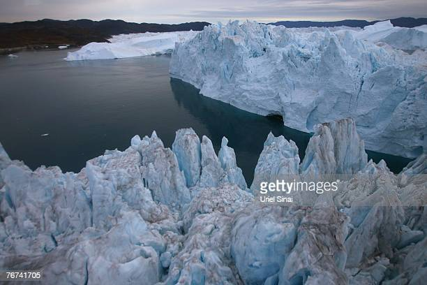 An aerial view of icebergs as they float out of the Jacobshavn Fjord into the Jacobshavn bay august 28 2007 near Ilulissat Greenland Scientists...