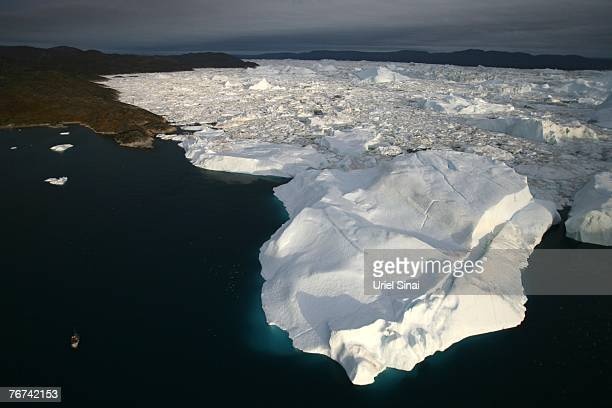 An aerial view of icebergs as they float out of the Jacobshavn Fjord into the Jacobshavn bay august 29 2007 near Ilulissat Greenland Scientists...