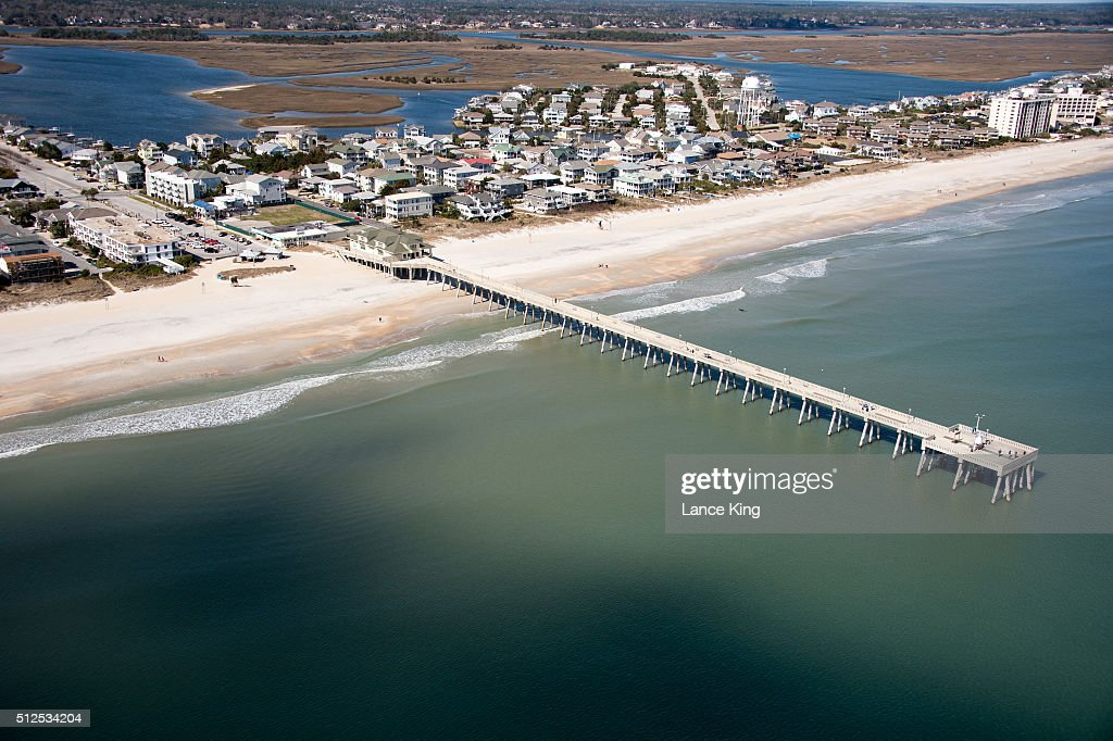 An aerial view of Johnnie Mercer's Pier along the Atlantic Ocean shoreline on February 26 2016 in Wrightsville Beach North Carolina