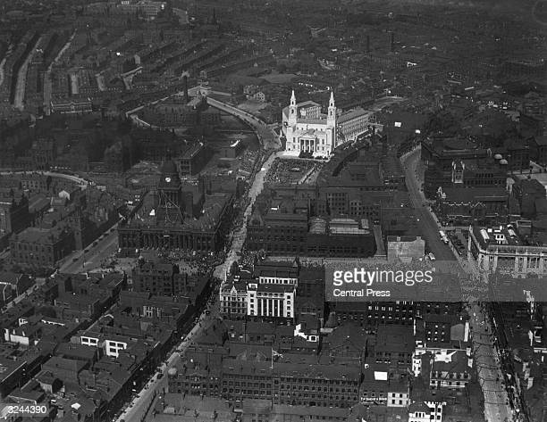 An aerial view of Leeds showing the new Civic Hall and the Victorian town hall on the Headrow