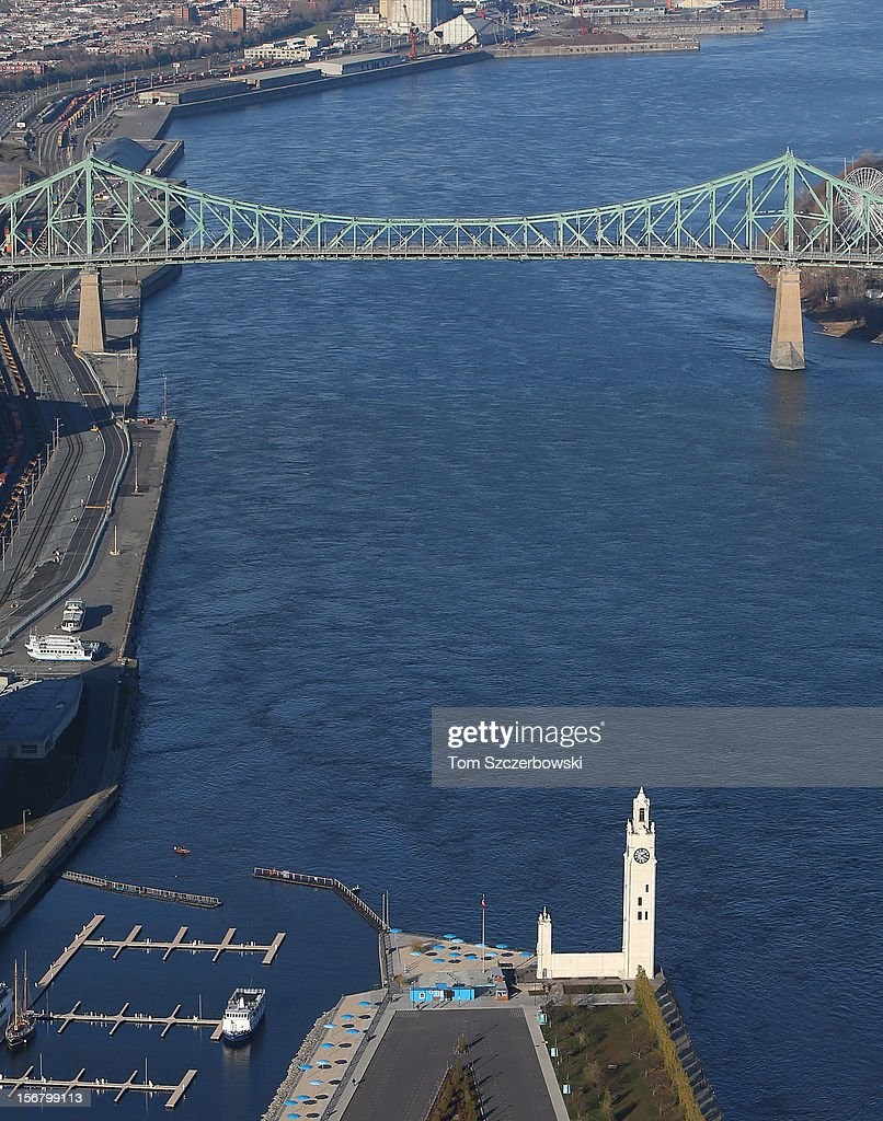 An aerial view of Montreal Clock Tower in the Old Port of Montreal and Jacques Cartier Bridge in the background are seen from above on November 18, 2012 in Montreal, Quebec.