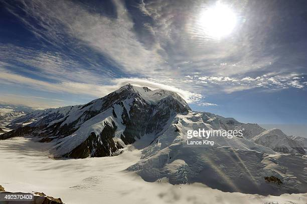 An aerial view of Mt McKinley as clouds hover just above on May 17 2014 in Denali National Park Alaska According to the National Park service the...