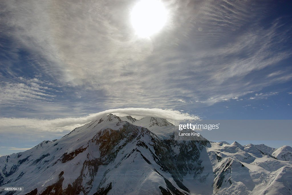 An aerial view of Mt. McKinley (top center) as clouds hover just above on May 17, 2014 in Denali National Park, Alaska. According to the National Park service, the summit elevation of Mt. McKinley is 20,320 feet above sea level, making it the highest mountain peak in North America.