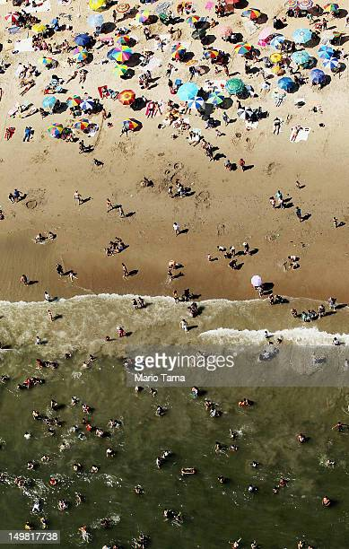 An aerial view of New Yorkers taking in the sun on a beach at Coney Island on August 4 2012 in the Brooklyn borough of New York City The past year...