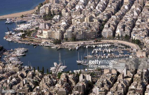 An aerial view of Piraeus Athens' port city taken 13 July 2004 one month ahead of the Athens August 1329 Olympics Eight cruisers including the...