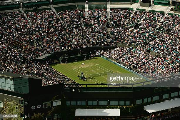 An aerial view of play on a roofless Centre Court taken from the BBC elevated camera position during day four of the Wimbledon Lawn Tennis...