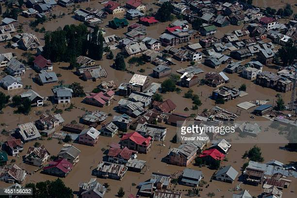 An aerial view of residential houses submerged in flood waters on September 10 2014 in Srinagar the summer capital of Indian administered Kashmir...