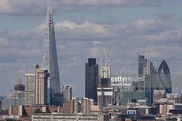 An aerial view of south London looking from Camberwell towards the City and the tall Shard Fastrising towers and the newest office blocks climb into...