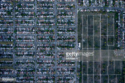 An aerial view of suburbian housing and cemetery