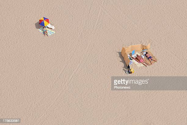 An aerial view of sunbathers on De Haan beach taken from a helicopter on July 17 2013 in Belgium