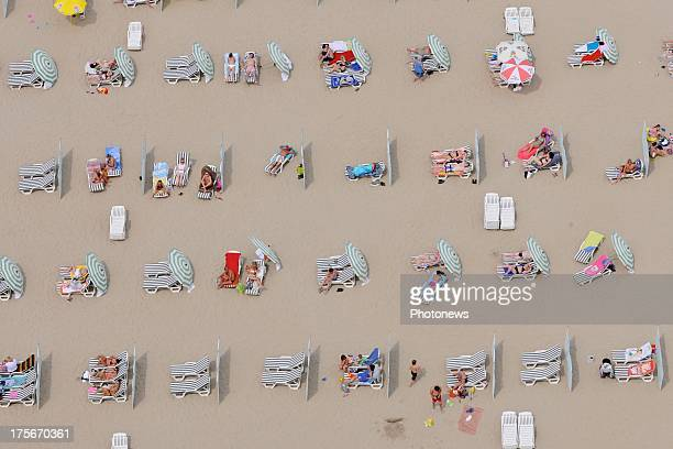 An aerial view of sunbathers on Koksijde beach taken from a helicopter on July 17 2013 in Belgium