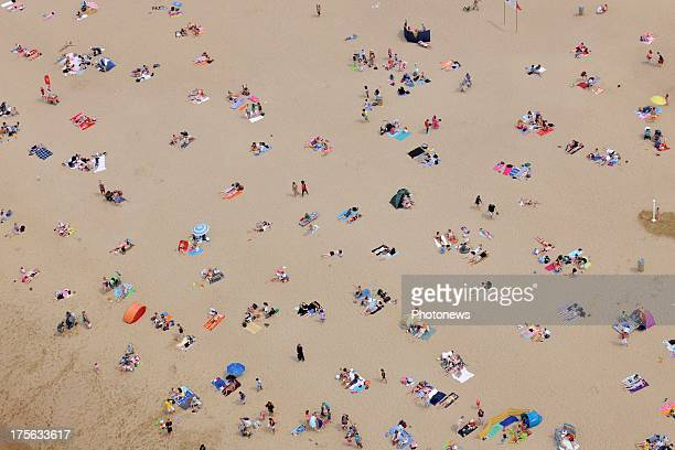 An aerial view of sunbathers on Oostende beach taken from a helicopter on July 17 2013 in Belgium