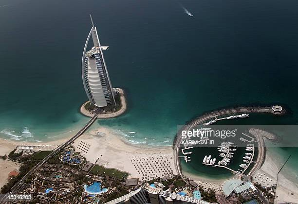 An aerial view of the 321 meter tall Burj AlArab luxury hotel built on an artificial island off Jumeirah in the Gulf emirate of Dubai on May 27 2012...