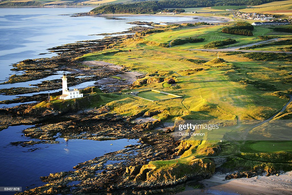 An aerial view of the 454 yard par 4 9th hole that runs past the lighthouse with the par 4 10th behind on the Ailsa Course at The Westin Turnberry...