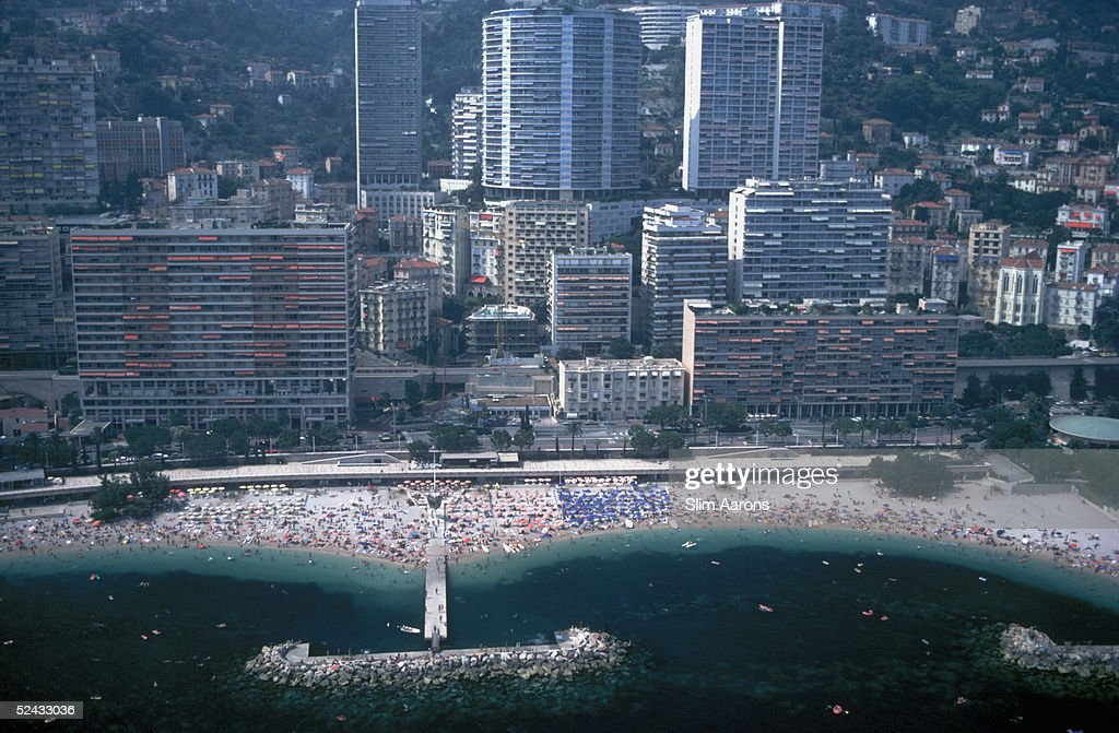 An aerial view of the beach at Monte Carlo with skyscrapers rising behind August 1981
