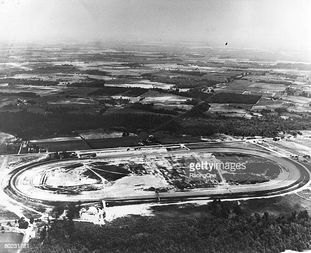 An aerial view of the brand new Darlington Raceway in 1950 Note the passenger bridge over the original backstretch and Sherman Ramsey's Pond near...