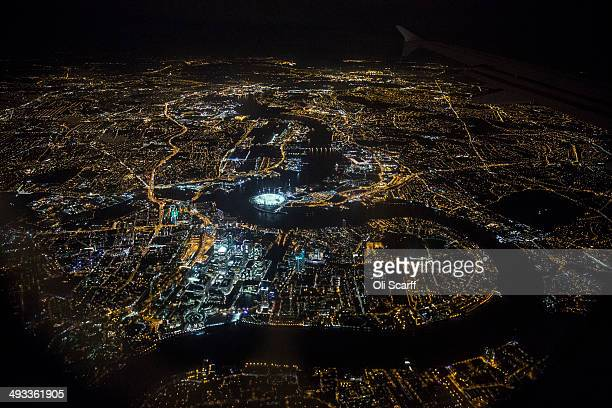 An aerial view of the buildings and streets of London including the O2 Arena and the Canary Wharf development on the Isle of Dogs which are...