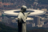 An aerial view of the Christ The Redeemer statue and the Maracana Stadium on November 12 2013 in Rio de Janeiro Brazil