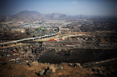 An aerial view of the city from a hilltop on November 12 2013 in Lima Peru While Peru's economy has expanded an average of 64 percent per year from...