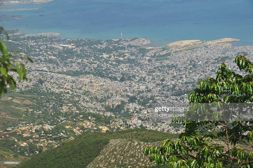 An aerial view of the city of Port-au-Prince from Morne Hopital on May 13, 2013. Port-au-Prince is devasted after flood and people working to halt erosion in Morne Hopital and protect the city of Port-au-Prince. Trees are being planted and retaining walls built to prevent landslides from flooding on the hillsides, to improve people's lives in the Western Hemisphere's poorest country. AFP PHOTO / Thony BELIZAIRE