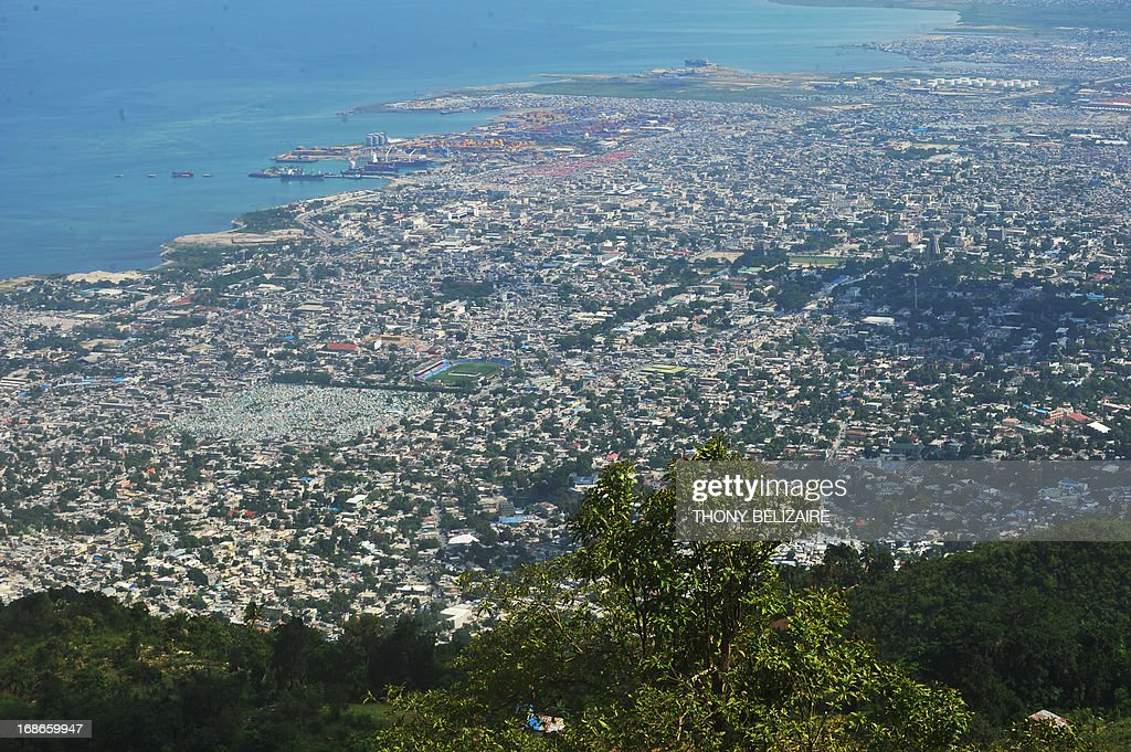 An aerial view of the city of Port-au-Prince from Morne Hopital on May 13, 2013. Port-au-Prince is devasted after floods and people are working to halt erosion in Morne Hopital and protect the city of Port-au-Prince. Trees are being planted and retaining walls built to prevent landslides from flooding on the hillsides to improve people's lives in the Western Hemisphere's poorest country. AFP PHOTO / Thony BELIZAIRE