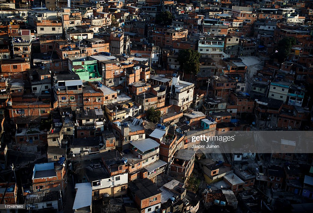 An aerial view of the Complexo do Alemao favela on June 29, 2013 in Rio de Janeiro, Brazil. It was at the end of 2010 that under the stage of pacification some 300 police officers went into the Complexo do Alemao with tanks and helicopters to drive out the criminal gangs to establish a permanent police presences and to set up social services such as schools, healthcare centers, and rubbish collection. The Complexo do Alemao favela is, with a population of 100, 000 and stretching for more than 3 kilometers with a maze of narrow alleys and stairways, one of the largest favelas in Rio de Janeiro.