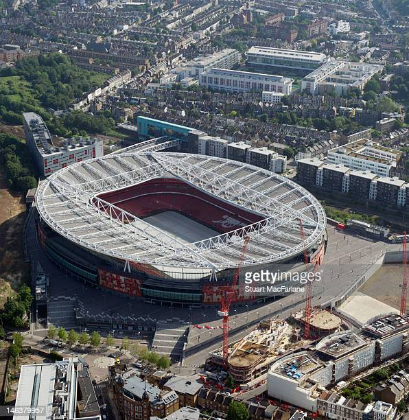 An aerial view of The Emirates Stadium home of Arsenal Football Club with old stadium Highbury in the background on June 14 2012 in London England