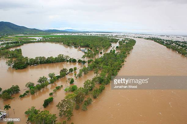 An aerial view of the Fitzroy river leading into the city on January 6 2011 in Rockhampton Australia Floodwaters peaked at 92 metres yesterday in the...