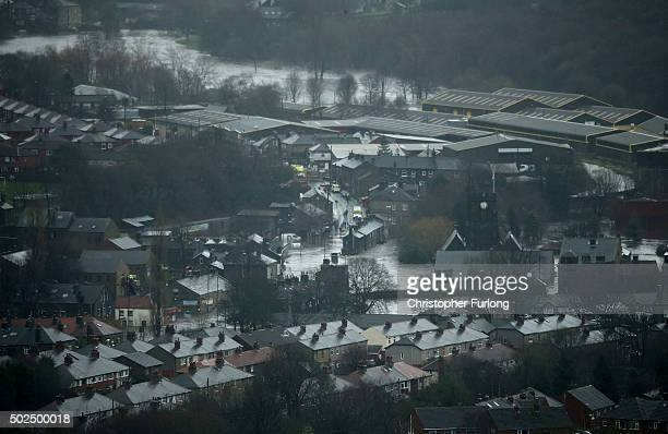 An aerial view of the floodwaters after rivers burst their banks on December 26 2015 in Hebden Bridge England There are more than 200 flood warnings...