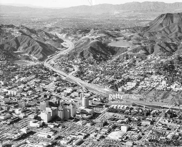 An aerial view of the Hollywood district the Cahuengha Pass and the San Fernando Valley gives some idea of the growth of Los Angeles which sprawls...