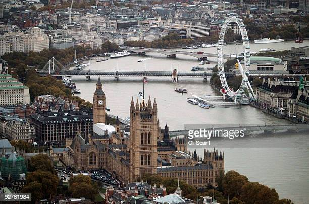 An aerial view of the Houses of Parliament and the London Eye Ferris wheel on November 4 2009 in London England The UK's capital city is home to an...