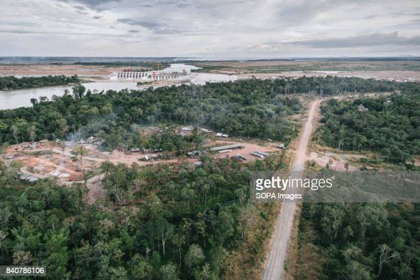 An aerial view of the Lower Sesan II Dam and the logging camp Local communities refuse to be removed Once the dam is in operation the waters will...