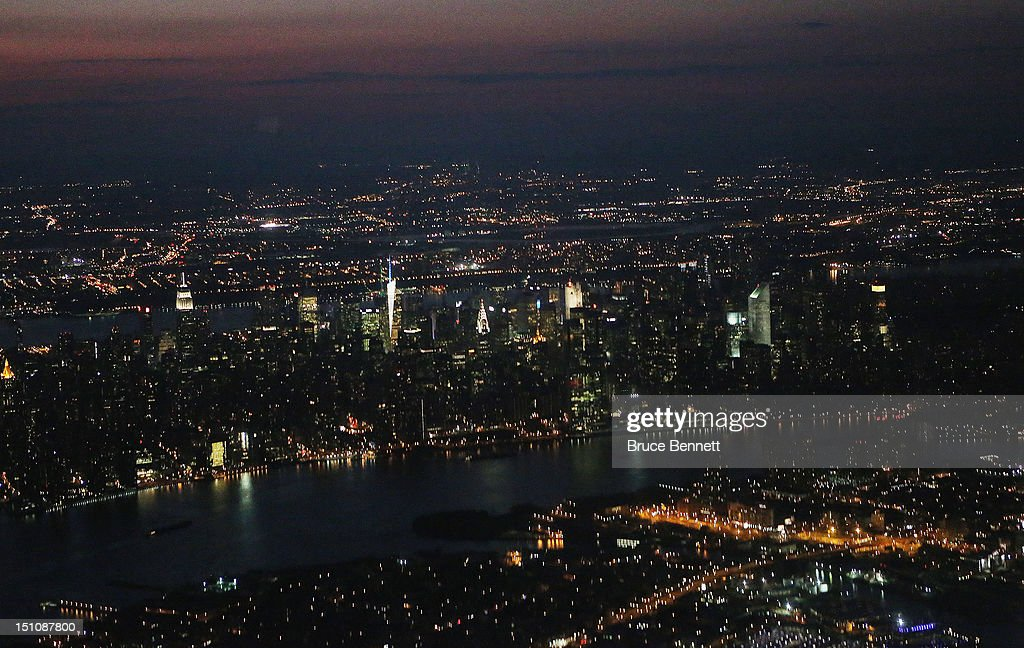 An aerial view of the Manhattan skyline at sunset as photographed from an airplane on August 28, 2012 in New York, New York.